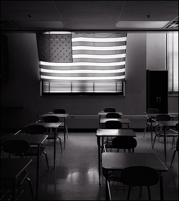A large American flag hangs over the windows in the back of a classroom at North Side High School in Fort Wayne, Indiana.