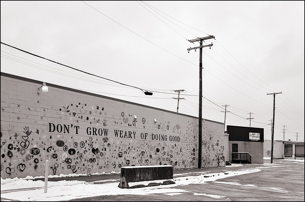 Don't Grow Weary Of Doing Good, written on the side of a building on Cass Street in Fort Wayne, Indiana. Heart of the City Mission Foundation.