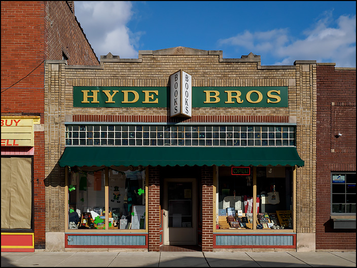Hyde Brothers Books on Wells Street in Fort Wayne, Indiana. The shop is in a historic yellow brick storefront whose front windows are full of books.