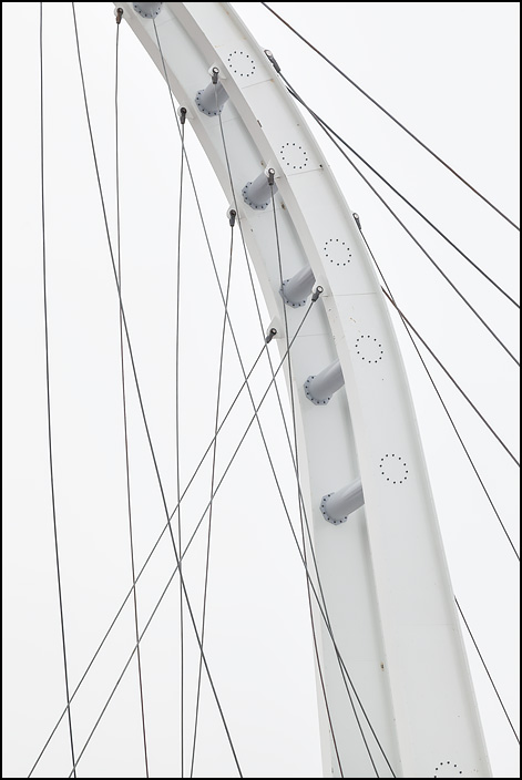 A tangle of cables hang from the steel tower of a cable stayed bridge under construction at IPFW in Fort Wayne, Indiana.