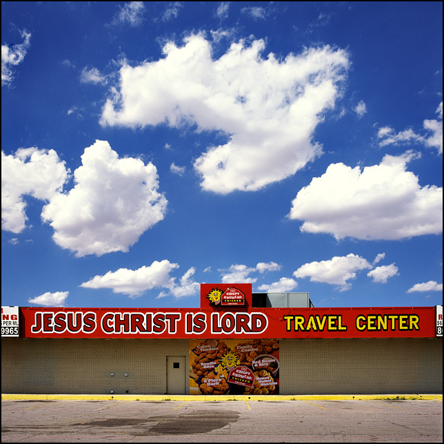 The Jesus Christ is Lord Travel Center on Interstate 40 in Amarillo, Texas. The signs on the front advertise Krispy Krunch Chicken.