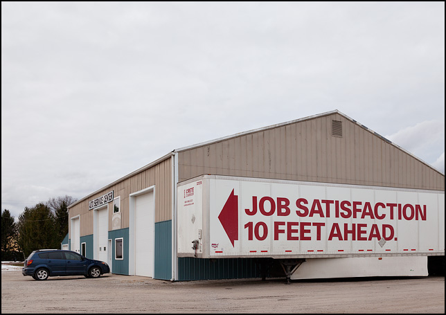 Job Satisfaction 10 Feet Ahead. A help-wanted ad on the side of a semi truck trailer.