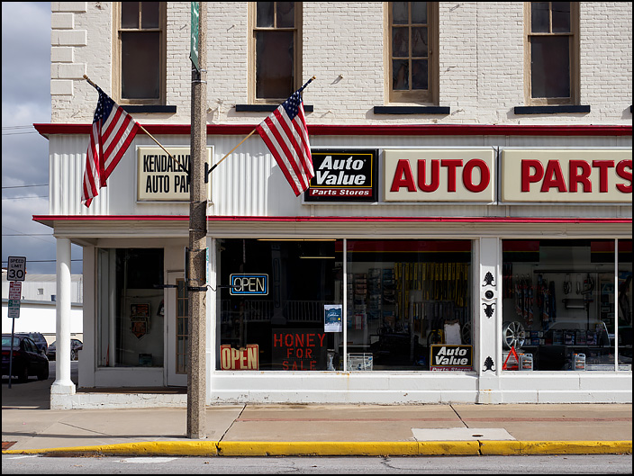 Kendallville Auto Parts is an Auto Value Parts store in a large brick building on Main Street in the small town of Kendallville, Indiana. A sign in the front window says they also have Honey For Sale.