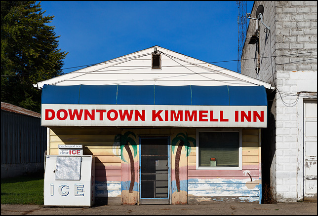 Downtown Kimmell Inn, a bar in an old building on Clark Street in the small town of Kimmell, Indiana. The front of the building has palm trees and a tropical sunset painted on the front of it.