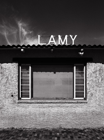 The window and sign on the Spanish style adobe railroad depot at Lamy, New Mexico with terracotta tile roof.