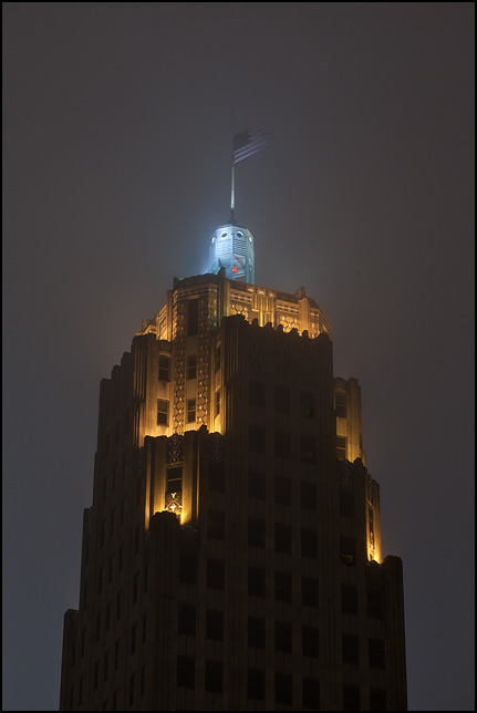 The American flag flies from the top of the Lincoln Tower on a foggy night in Fort Wayne, Indiana.