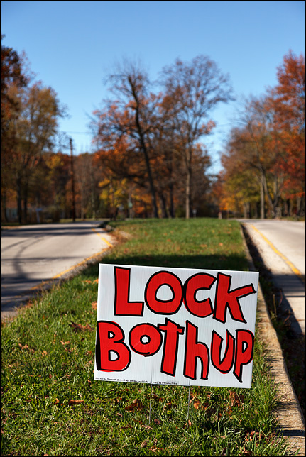 A handmade political sign that says, Lock Both Up. 2016 presidential election Donald Trump and Hillary Clinton.