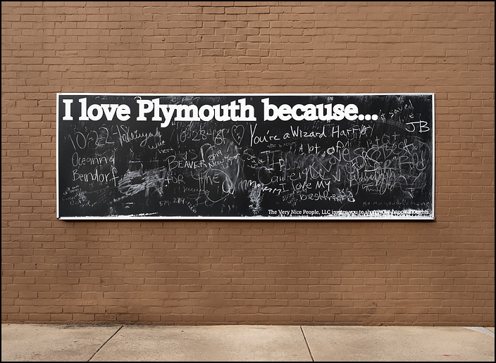 A blackboard that asks people to write why they love the small town of Plymouth, 