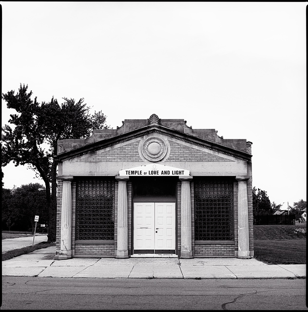 The Temple of Love and Light Church on Maumee Avenue in Fort Wayne, Indiana. This brick building was once a bank with Greek revival columns and pediment. The sign above the doors has an Egyptian Ankh symbol.