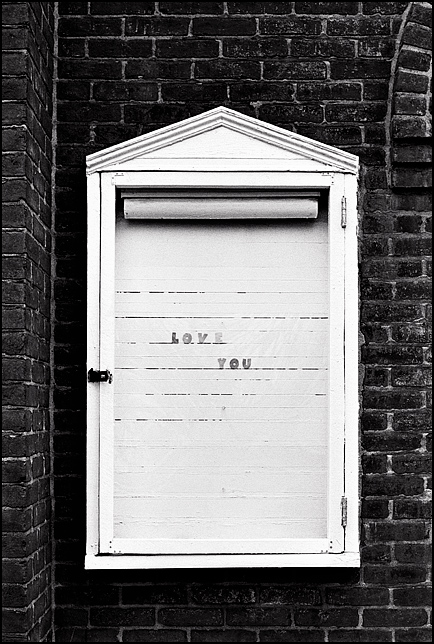A sign that says I Love You on the front of an old brick church on Muhammed Ali Road in Louisville, Kentucky.