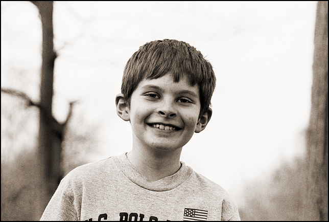 My son, MacKenzie Crawford, smiling at age 10. It was the first time in a year that he had seen me.