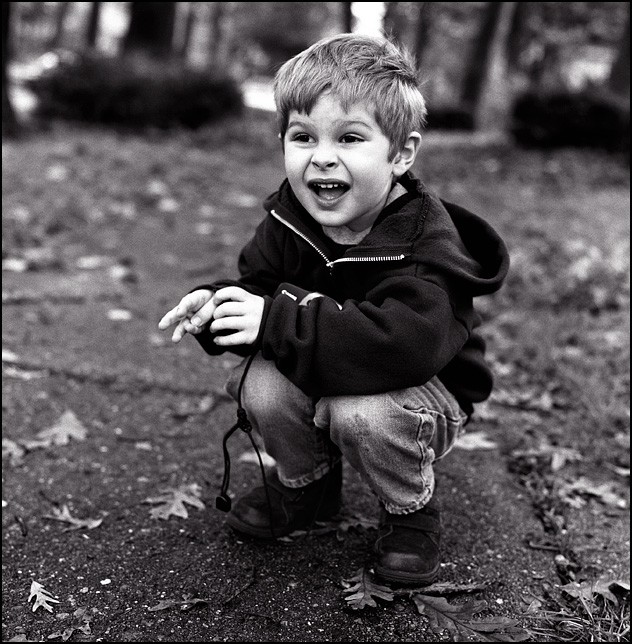 My four year old son MacKenzie Crawford smiles after taking pictures with his own camera.
