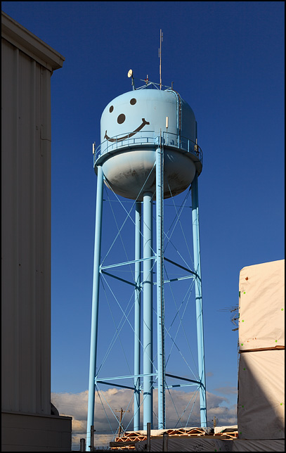 A blue water tower with a smiley face in the small town of Markle, Indiana.