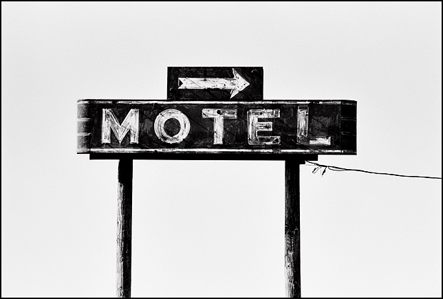 An old Route 66 era neon motel sign with an arrow along Interstate 44 in Marshfield, Missouri.