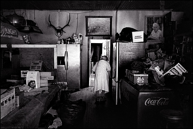 Ninety five year old Mary Mora walks to her home in the back rooms of the bar she owns in Cerrillos, New Mexico.