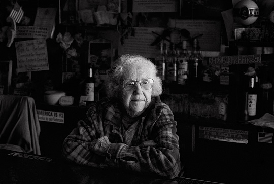 Ninety year old bartender Mary Mora sits behind the counter of her small town saloon in Cerrillos, New Mexico.