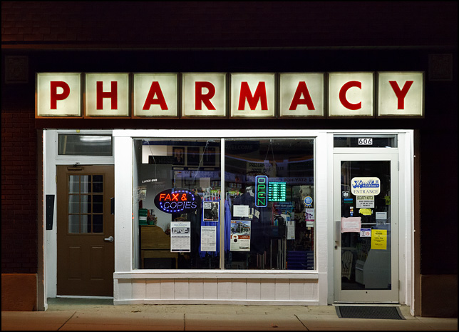 A night photograph of Merrill Pharmacy on Main Street in downtown Mishawaka, Indiana.
