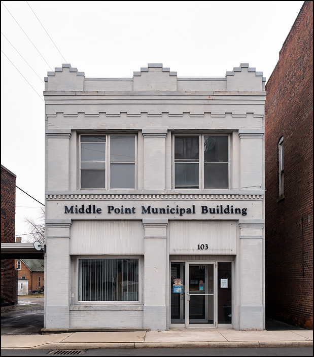 Middle Point Municipal Building on Adams Street in the small town of Middle Point, Ohio. The gray brick building is a former bank.