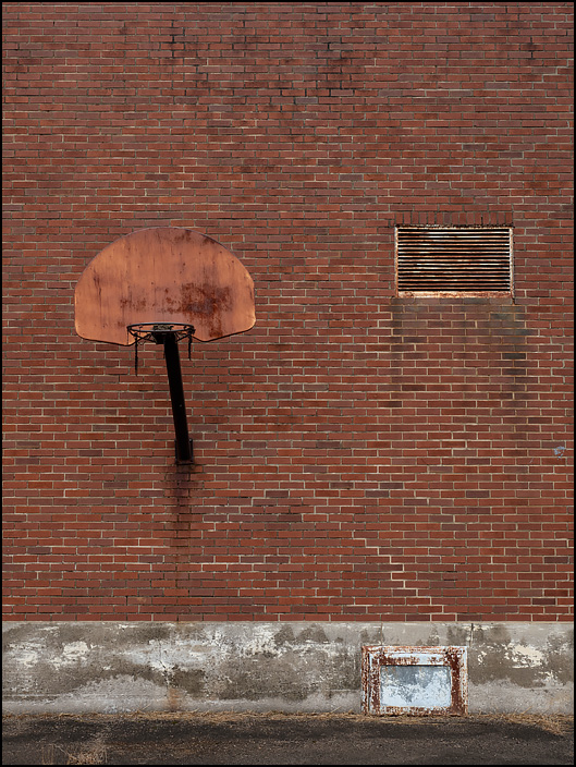 A basketball hoop on the back of the abandoned Middle Point School on Normal Street in the small town of Middle Point, Ohio.