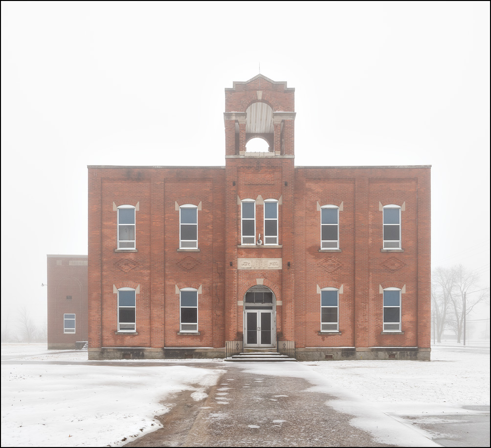 Middle Point School on a foggy winter morning in the small town of Middle Point, Ohio. Two story brick school built in 1885.