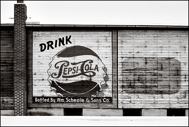 An old advertisement for Pepsi-Cola bottler William Scheele and Sons painted across the side of the old Fort Wayne Mirror Works building on Broadway.