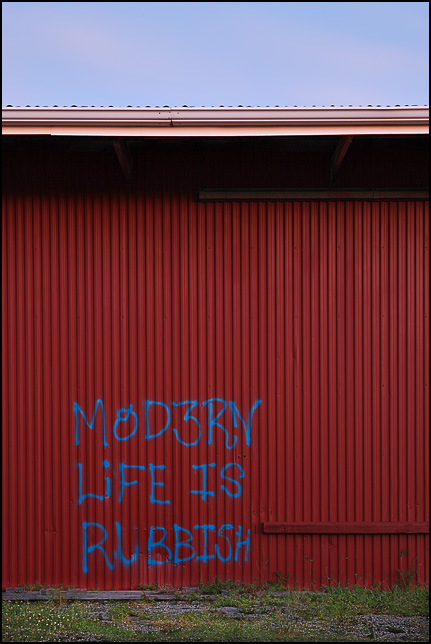 Modern Life Is Rubbish, graffiti spray painted on the side of an abandoned industrial building in Fort Wayne, Indiana.