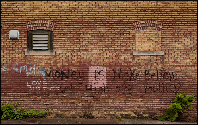 Graffiti on an old brick building on Alliger Street in Fort Wayne, Indiana. Money Is Make Believe, Get High Off Youth. Love No THOTs.