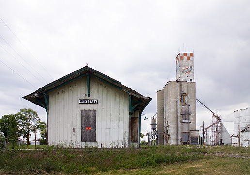 Abandoned railroad depot and Check-Mix grain elevator in Monterey, Indiana.