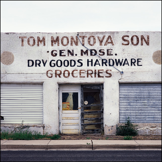 The abandoned Tom Montoya Son store on US-285 in Encino, New Mexico. The sign says Dry Goods, Hardware, Grocery, and General Merchandise.