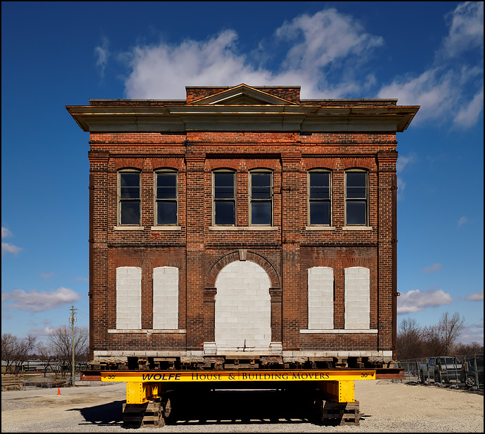 The 122 year old Cambray Building, a large brick building, being moved in downtown Fort Wayne, Indiana.