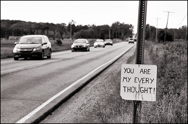 Cars drive by a sign that says, You Are My Every Thought.