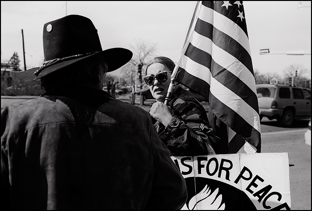 A member of Veterans For Peace talks to another antiwar activist during the weekly peace demonstration in Santa Fe, New Mexico.