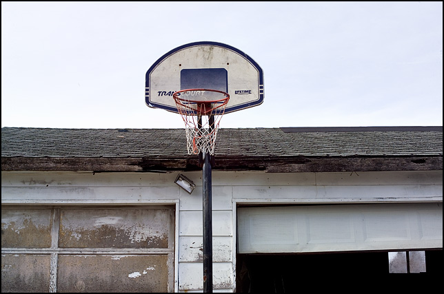 A basketball hoop on the front of a garage in rural Allen County, Indiana.