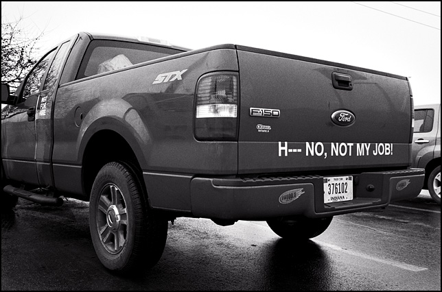 Hell No, Not My Job! Written on the tailgate of a Ford F-150 pickup truck.
