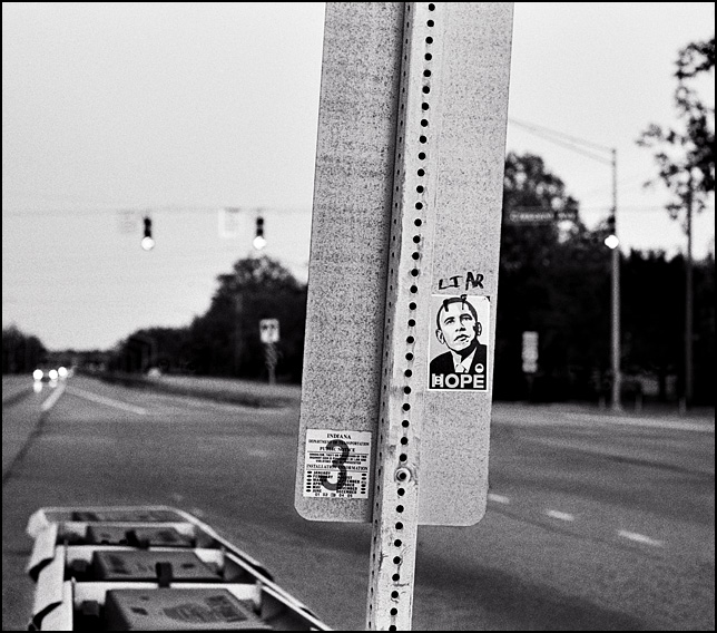 An Obama Hope sticker defaced with devil horns and the word Liar written above it on the back of a road sign.