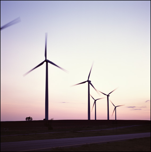 A group of wind turbines at sunset along Interstate 40 near Weatherford, Oklahoma.