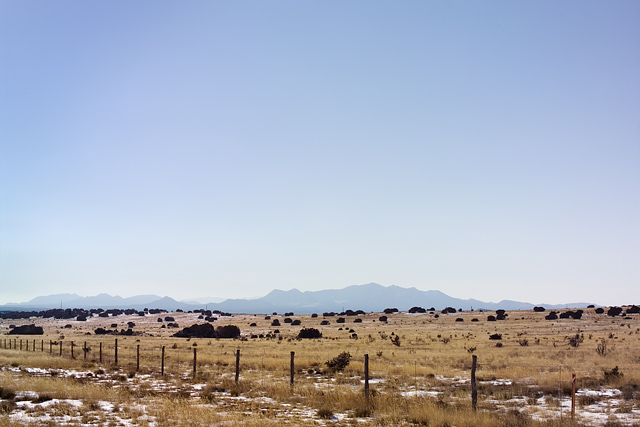 The Ortiz Mountains rise in the distance over the desert plains of New Mexico.