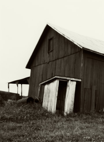 Pinhole photograph of an old barn and an abandoned outhouse in rural Allen County, Indiana.