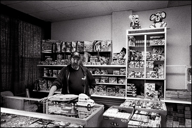 The owner of Packrats Mini Flea Market on Wells Street standing in front of his huge display of old Lego sets and other toys.