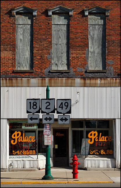 Palace Pizza is a small locally-owned pizzeria on High Street in the small town of Hicksville, Ohio. The old brick building has a corrugated steel facade on the restaurant storefront and the second floor windows are boarded up.