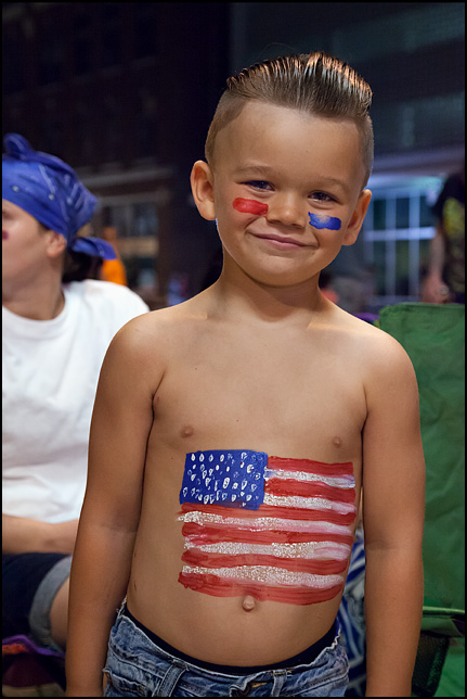 A little boy with an American flag painted on his stomach at the 2017 Fourth of July Fireworks in Fort Wayne, Indiana.