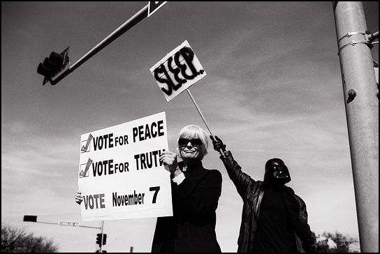 Two anti-war demonstrators in Santa Fe during the weekly Friday afternoon protest against the war in Iraq. One protester is dressed as Darth Vader and holds a sign that says Sleep and the other one holds a sign that says Vote for Peace, Vote for Truth, Vote November 7.