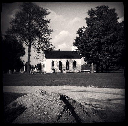 The little old white church in the Prairie Grove Cemetery in Waynedale, photographed with a Diana toy camera.