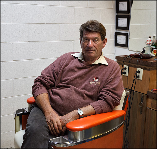 Phil Luginbill sits in his barber chair at Time Corners Barber Shop in Fort Wayne, Indiana.