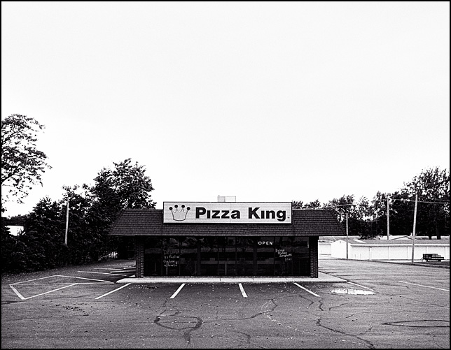 The parking lot is completely deserted at the Pizza King restaurant on Bluffton Road in Fort Wayne, Indiana.