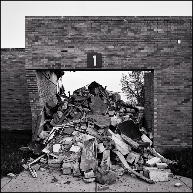 A pile of broken bricks and cinderblocks pouring out of a door during the demolition of Pleasant Center Elementary School outside Fort Wayne, Indiana.