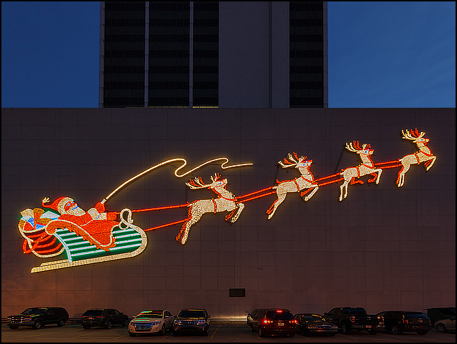 The historic Wolf and Dessauer lighted Santa Claus display on the side of the PNC Bank Building on Main Street in downtown Fort Wayne, Indiana.