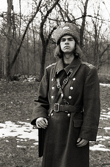 Self portrait of fine art photographer Christopher Crawford wearing a Soviet Russian Army officer's coat and fur hat with sam browne belt and colonel rank insignia.