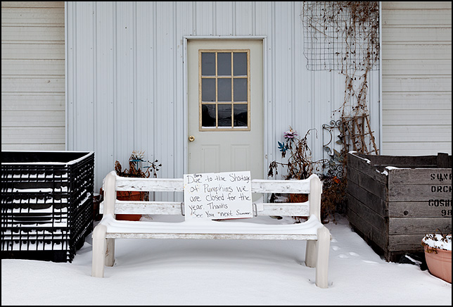 A sign posted on the snow-covered bench in front of Hardy's Farm Market in Fort Wayne says that the store is closed due to the pumpkin shortage of 2011.