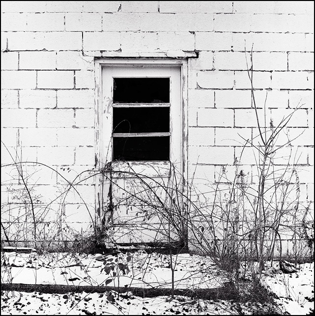 A door in a cinderblock building at the abandoned Pure Sealed Dairy on Bass Road in Fort Wayne, Indiana.